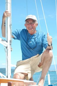 Scott Reed on a sailboat